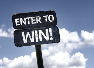 Enter To Win sign with clouds and sky background attract leads to your next manufacturing expo