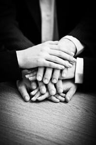 5 Ways to Use Blogging to Attract New Business and help your business grow -Image of business partners hands on top of each other symbolizing companionship and unity
