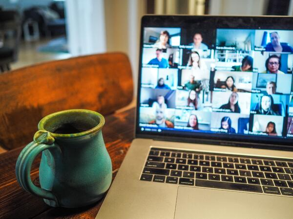 How to keep your sales team motivated. Maintain communication video chat on a computer screen