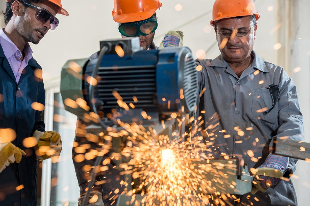 Industrial background - welder in a factory- qualified Lead in Manufacturing