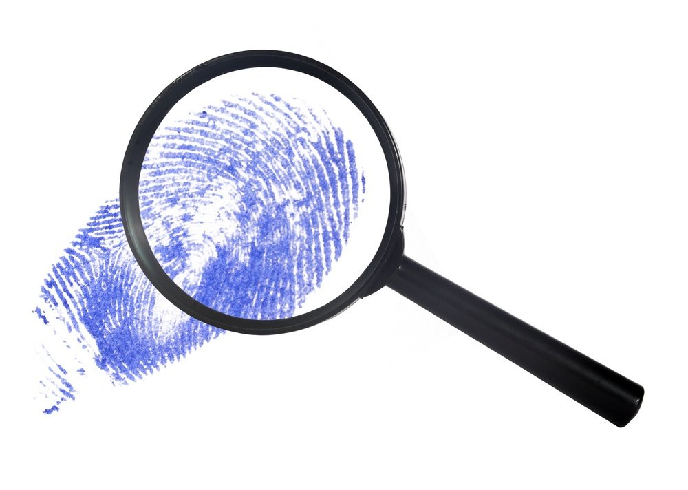 GDPR guide magnifying glass over a blue digital finger print data protection