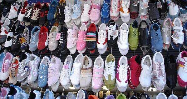 helping is selling, selling shoes are on a market stall